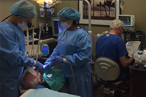 Dr. Dankworth, an Oceanside implant dentistry expert, performing a tooth implant procedure for a Vista CA patient.