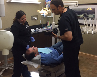 Dr. Dankworth works on patient's dental veneers in Oceanside CA.