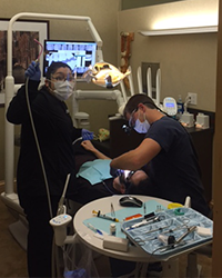 Image of Dr. Dankworth providing restorative dentisty to patients with broken, cracked, or missing teeth in the Oceanside, Fallbrook, and Vista CA areas.